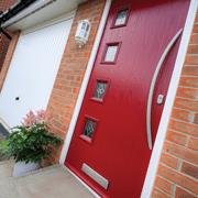 poppy red composite door with curved long bar