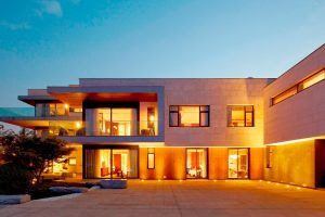 warm lit contemporary home with aluminium windows and bi fold doors