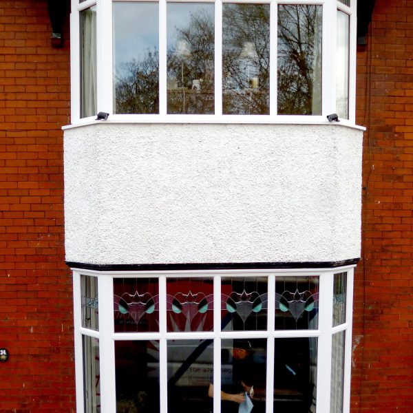 double bay window with traditional glass design
