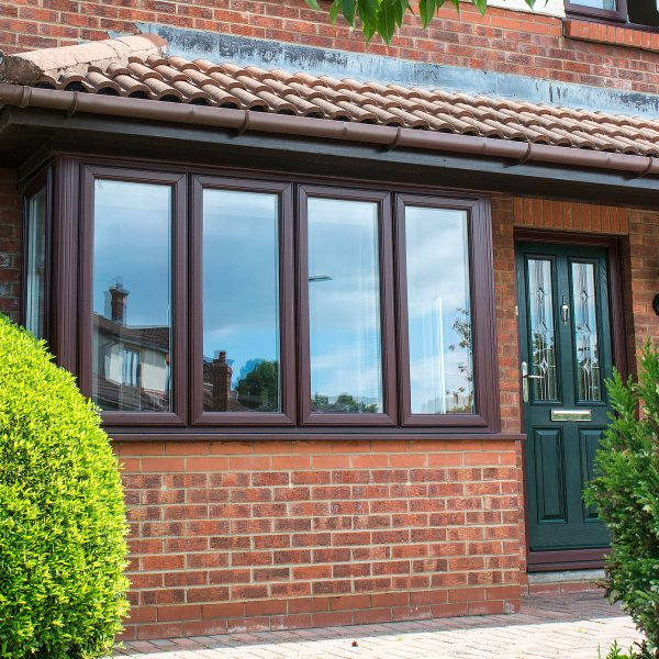 brown upvc bay window with green composite door