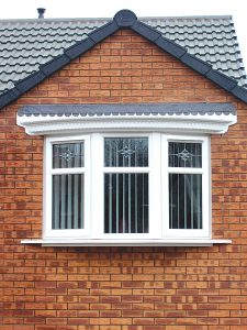 large white upvc bay window with flat roof