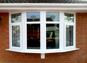 large white upvc bay window with floral glass