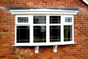 large white upvc bay window with lead design