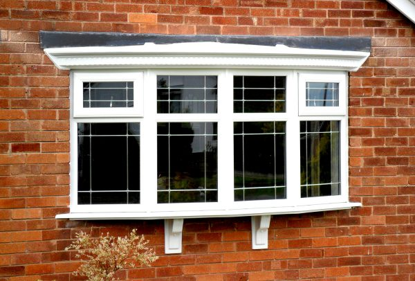 Bow Window Pane with decorative glass in white uPVC