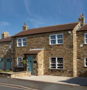 cottage with tilt and turn sash windows