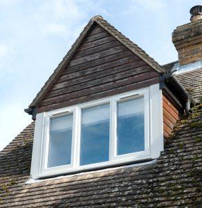 White Tilt & Turn upvc windows on a roof top bay