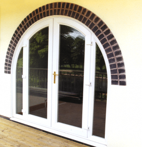 large arched white upvc patio doors