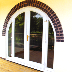 white upvc arched patio doors
