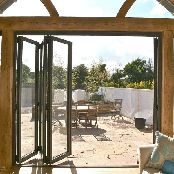 internal image of bifold doors in a large timber frame