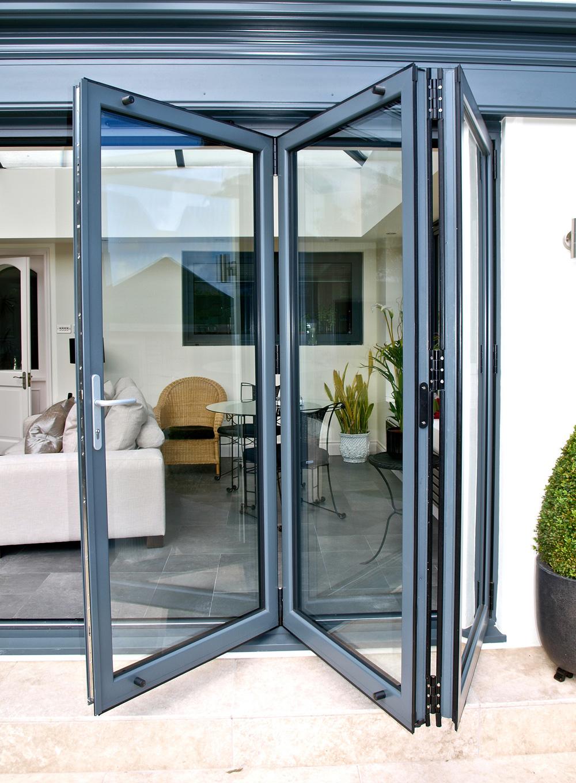 Bi folding doors bespoke bi fold doors st helens windows for Folding window