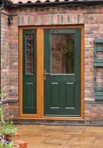 dark green composite door with light oak frame