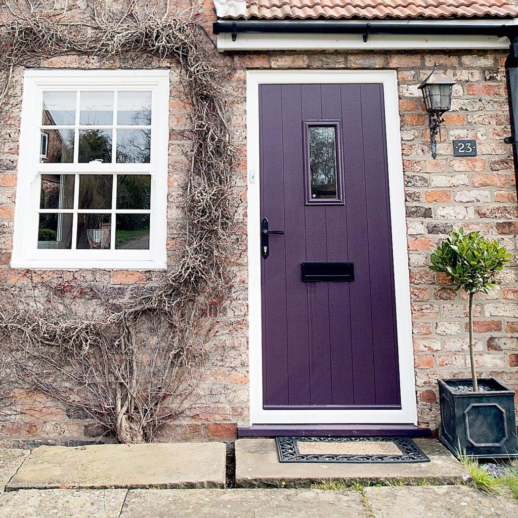 purple composite door with casement upvc window