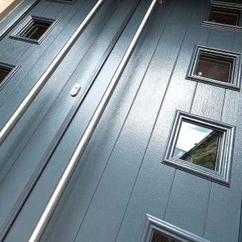 turquoise composite door with long bars