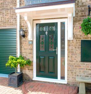 dark green composite door with green garage door