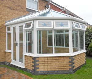 contemporary upvc conservatory with patio doors