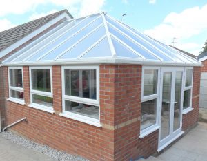 Conservatory with large glass roof and patio doors