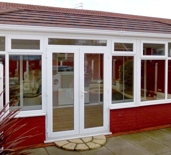 Contemporary double glazed conservatory with tiled roof