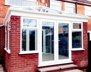 red brick conservatory with double glazed upvc patio doors