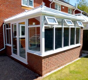 Conservatory with a row of white upvc windows
