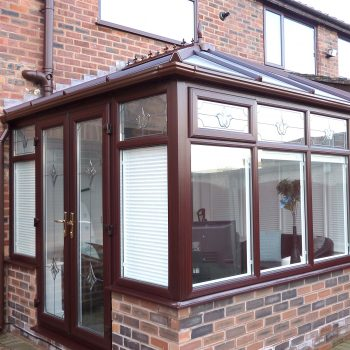 Brown French Doors on a modern upvc conservatory