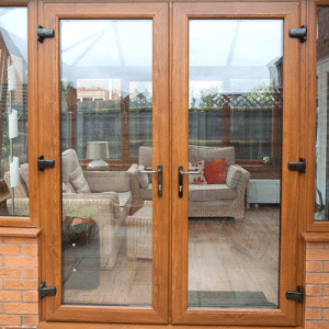 oak upvc french doors on a conservatory