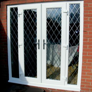french white upvc doors with lead design