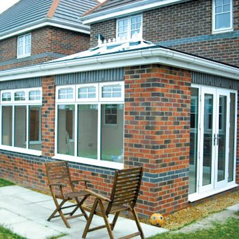 mixed brick orangery with lantern roof upvc windows and patio doors