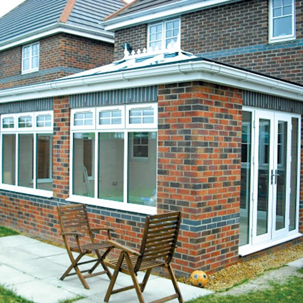 mixed brick orangery with upvc windows and patio doors