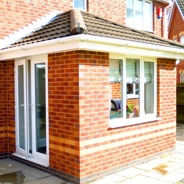 Small solid tiled roof Orangery