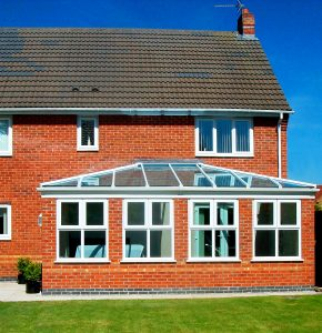 red brick orangery with new guttering from St Helens Windows