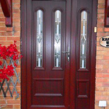 dark wood upvc panel front door with side panel