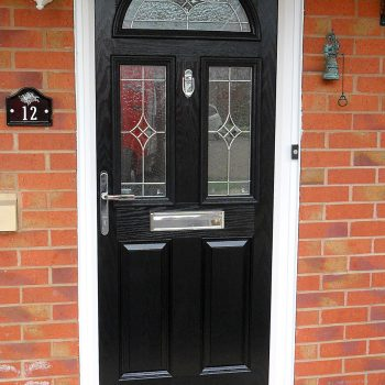 Composite black panel door with white upvc frame