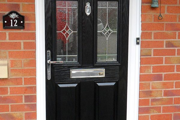 Composite black panel door with white upvc frame