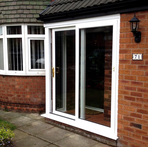 Sliding doors with white upvc bay windows