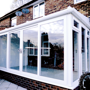 conservatory with tiled roof and white upvc
