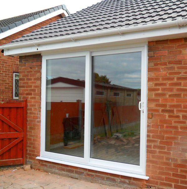 White uPVC patio glass doors on red brick