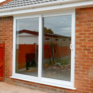 large sliding white upvc patio doors