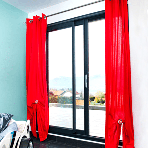 black Aluminium patio doors with red curtains