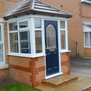 uPVC porches a blue composite door and white upvc porch