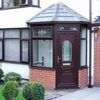 dark brown upvc porch with upvc windows