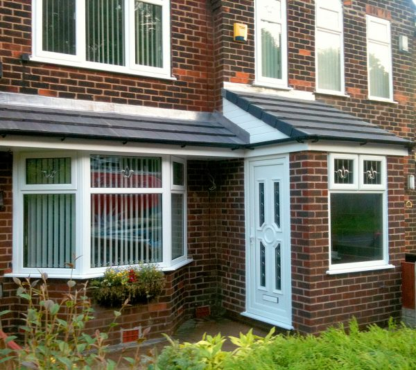 Colour matched brick porch with lightweight tile roof and white upvc door on the side of the porch