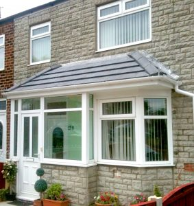 white upvc porch with lightweight tiled roof