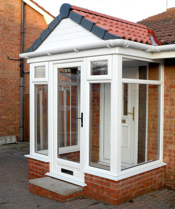 modern white upvc porch with red tiled roof
