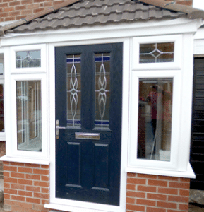 uPVC porches a grey compoite door with white upvc frame and tiled porch