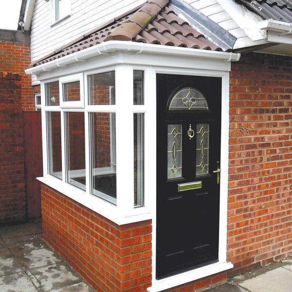 Side white upvc porch with black composite door