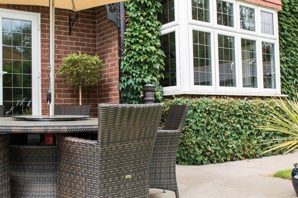 Garden image showing bay window and patio doors