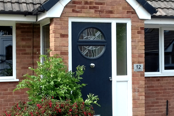 Espirit composite fitted door Steel blue and patterned glass