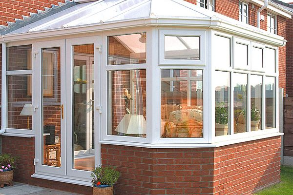 white upvc conservatory on a summers day