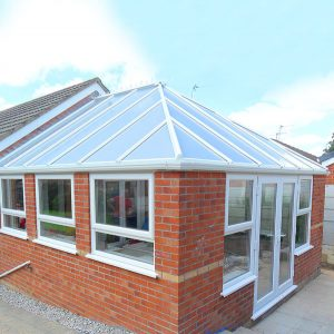 red brick orangery with glass roof