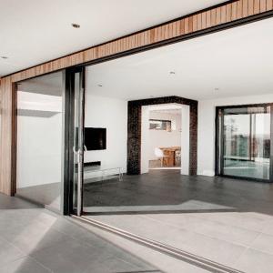 Bifolding doors leading to open plan room